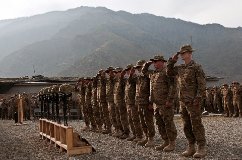 Soldiers assigned to Abu Company, 1st Battalion, 327th Infantry Regiment (Task Force Bulldog), 1st Brigade Combat Team, 101st Airborne Division, render a final salute to their six fallen brethren during a memorial service at Combat Outpost Honikker Miracle in eastern Afghanistan's Kunar Province Nov. 21st. (Photo by U.S. Army Staff Sgt. Mark Burrell, Task Force Bastogne Public Affairs)
