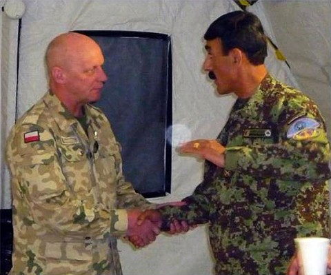 Brig. Gen. Andrezej Reudowica, Polish Brigade commander, shakes hands with Ghazni 3rd Brigade Afghan National Army Commander Col. Daoud Shah Wafadar at the Polish Independence Day ceremony Nov. 10th. Afghan partners attended the ceremony as a sign of respect for their Polish partners working to help the Afghan people attain their independence as well. (Photo by U.S. Army Staff Sgt. Derek Dosedel, Task Force Iron Rakkasan)
