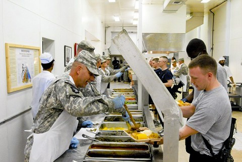 U.S. Army Command Sgt. Maj. Dan Kerrigan of Otterbien, IN, and other senior-enlisted members from the 3-19th Indiana Agribusiness Development Team serve Thanksgiving dinner to the troops of Forward Operating Base Salerno Nov. 25th. (U.S. Army photo by Staff Sgt. Andrew Guffey, Task Force Rakkasan Public Affairs)