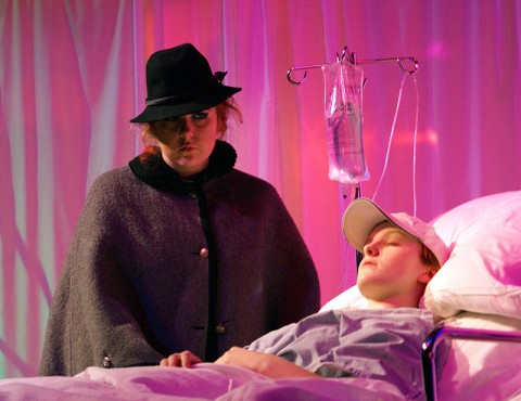 """Senior students Grace Mason (in hospital bed) and Samantha Bagwell star in Margaret Edson's powerful play, """"WIT."""""""
