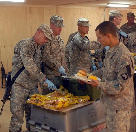 U.S. Army Command Sgt. Maj. Greg Patton, from Vincennes, IN, senior non-commissioned officer for 3rd Brigade Combat Team, 101st Airborne Division, serves Christmas dinner to Soldiers of 1st Battalion, 187th Infantry Regiment, in Bak, Afghanistan, Dec. 25th. (U.S. Army Photo by Pfc. Chris McKenna)