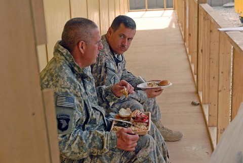 Two U.S. Army Soldiers eat Christmas dinner in Bak, Afghanistan, December 25th. (U.S. Army Photo by Pfc. Chris McKenna)