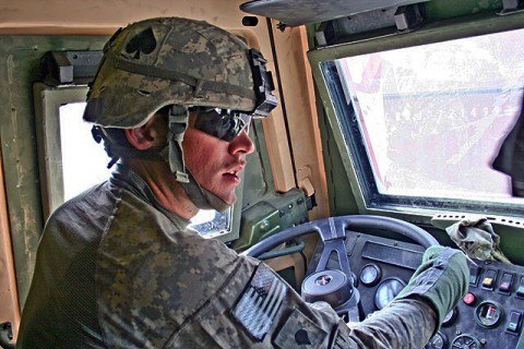U.S. Army Spc. Garrett Bartlett, maneuvers his light medium tactical vehicle trailer through the supply yard Nov. 17th at Forward Operating Base Fenty. Bartlett, a native of McQueeney, Texas, has driven more than 11,000 miles of convoy routes since arriving in country three months ago. (Photo by U.S. Army Staff Sgt. Ryan C. Matson, Task Force Bastogne Public Affairs)
