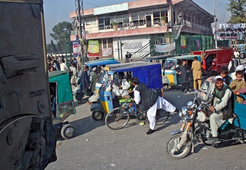One of the challenges the McQueeney, Texas, native, U.S. Army Spc. Garrett Bartlett and the other truck drivers from Troop D, 1st Squadron, 61st Cavalry Regiment face on convoys is driving their large military vehicles through the busy city streets of Jalalabad. (Photo by U.S. Army Staff Sgt. Ryan C. Matson, Task Force Bastogne Public Affairs)