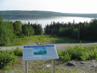 The Interpretive sign for the Arrow Air Flight 1285 memorial at Gander Lake
