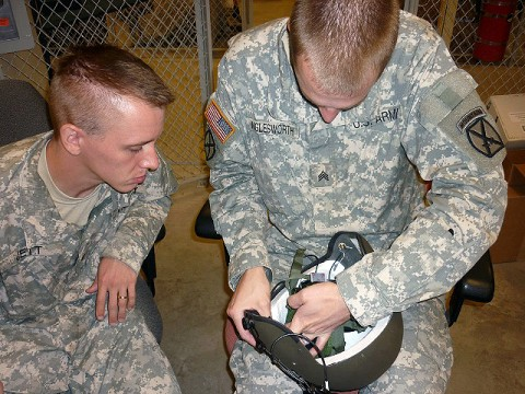 U.S. Army Sgt. Phillip Wiglesworth of Lenexa, KS, shows U.S. Army Sgt. Anthony Jett of Warrensburg, MI, how to install the Hearthru modification on a helmet used by flight crews. Both Soldiers are noncommissioned officers working in the aviation life support shop of Company D, 3rd Battalion, Task Force Phoenix, 10th Combat Aviation Brigade, 10th Mountain Division. (Photo by U.S. Army Sgt. Buck Atkin, Task Force Phoenix)