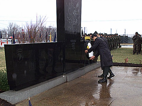 US Army Lieutenant Colonel Sidney McMannis (Obscured) and Command Sergeant Major Raymond Rodriquez (Foreground) place a wreath on the memorial for Task Force 3rd Battalion, 502nd Infantry Regiment, 2nd Brigade, 101st Airborne Division Soldiers.  This took place during the Division Gander Memorial Ceremony on December 12th, 1999, at Fort Campbell, Kentucky.  The Memorial commemorates the 248 soldiers lost in a plane crash at Gander, Newfoundland, Canada.