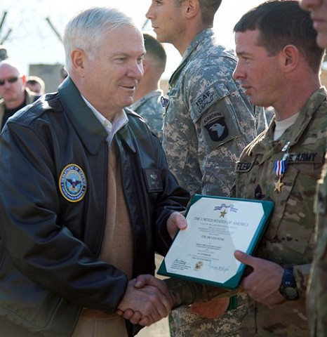 U.S. Army Sgt. 1st Class John P. Fleming of Alton, IL, 1st Battalion, 327th Infantry Regiment, 1st Brigade Combat Team, 101st Airborne Division, is awarded the Silver Star Medal by the Secretary of Defense Robert Gates at Forward Operating Base Joyce Dec. 7th. Fleming was awarded the Silver Star for valorous actions against armed and heavily fortified enemies during Operation Strong Eagle. (Photo by U.S. Army Spc. Andy Barrera/Released)