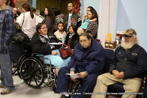 People waiting for their turn to visit the mobile food pantry.