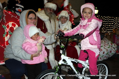A young girl visiting with Santa Claus at Christmas on the Cumberland received a brand new bicycle for Christmas
