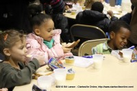 Kids eating their sack lunches at the Kiwanis Club Children's Christmas Party