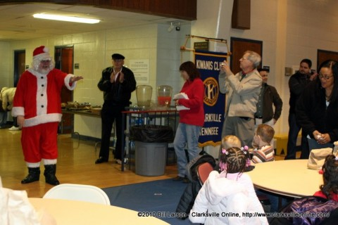 Santa comes into visit with the children at the Kiwanis Club Children's Christmas Party