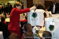 Annette Kalinowski from F&M Bank helps distribute the gifts to children