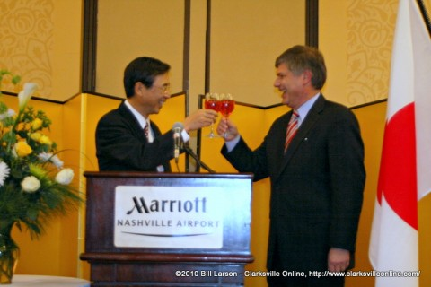 Consul-General Hiroshi Sato with Commissioner Matthew H. Kisber  toasting the Emperor of Japan
