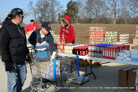 Kenny York checking to make sure everything is ready before they start serving those in need.