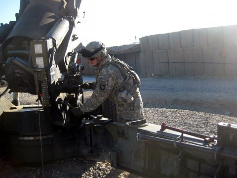 Cannon crewmember, U.S. Army Pfc. Raymond Cecil, Battery A, 2nd Battalion, 320th Field Artillery Regiment, raises the elevation on the howitzer Dec. 12th at Forward Operating Base Kalagush. Cecil, a Nashville, TN, native, is currently deployed in eastern Afghanistan's Nuristan Province. He is scheduled to redeploy back to Fort Campbell, KY, with his unit in the spring. (Photo by U.S. Army Sgt. Bill Murray, 1st Brigade Combat Team, 101st Airborne Division)