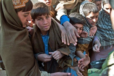 Afghan boys crowd each other to get a piece of candy handed out by Afghan National Army combat medics outside the Mannakhil Comprehensive Health Care Center in Sherzad District in eastern Afghanistan's Nangarhar Province Dec. 26th. (Photo by U.S. Army Staff Sgt. Mark Burrell, Task Force Bastogne Public Affairs)