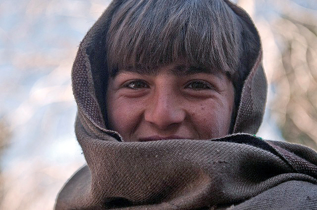 An Afghan boy smiles after being seen by doctors during a free clinic at the Mannakhil Comprehensive Health Care Center in Sherzad District in eastern Afghanistan's Nangarhar Province Dec. 26th. (Photo by U.S. Army Staff Sgt. Mark Burrell, Task Force Bastogne Public Affairs)