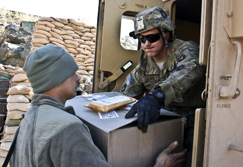 U.S. Army Spc. Anthony Ludwig (right) from Farley, Iowa, and U.S. Army Pfc. Jayson Vandeneinde from St. Petersburg, FL, both infantryman with Company A, 1st Battalion, 133rd Infantry Regiment, unload holiday mail Dec. 24th at Combat Outpost Najil. (Photo by U.S. Army Staff Sgt. Ryan C. Matson, Task Force Red Bulls Public Affairs)