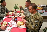 U.S. Army Sgt. Seth VanSteenwyck, native of Sigourney, Iowa, and a forward observer with Company A, 1st Battalion, 133rd Infantry Regiment, eats Christmas dinner Dec. 25th at Combat Outpost Najil. (Photo by U.S. Army Staff Sgt. Ryan C. Matson, Task Force Red Bulls Public Affairs)