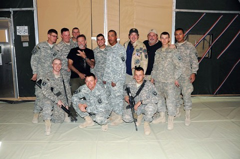 Soldiers from Task Force Currahee pose for a photo with actor Robin Williams, country music singer Kix Brooks and country music songwriter Bob Dipiero at Forward Operating Base Sharana Dec. 15th. (Photo by U.S. Army Spc. Christina Sinders, Task Force Currahee Public Affairs)