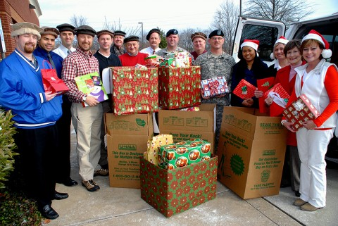 Pictured loading gifts for delivery to Fort Campbell are: Joey Bynum, Jermaine Haltom, Mark Proctor, Bill Coleman, Chris Bick, Art Helf, Martin Zorn, Doug Rogers, SGT Glen Strickler, Mike Sapp, SFC Nick Guilbeau, Teresa Welbeck, Beth Brown, Brenda Williamson, and Mary Lankford Benson.