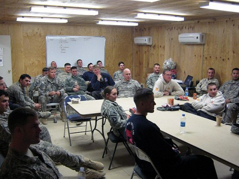 Staff and Soldiers of Task Force Iron Rakkasan gathered in the battalion's conference room on Forward Operating Base Andar to watch the 111th Army versus Navy football game Dec. 12th. (Photo by U.S. Army 1st Lt. R.J. Peek, Task Force Iron Rakkasan Public Affairs)