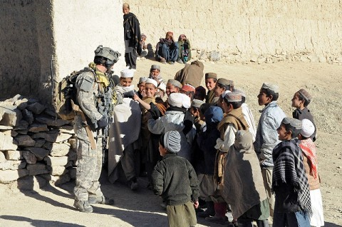 U.S. Air Force Staff Sgt. Matthew Hamblen, a terminal air control party member with the 14th Air Support Operations Squadron attached to Task Force Currahee, 4th Brigade Combat Team, 101st Airborne Division talks to Afghan children near the village of Shakhmodkhel during Operation Steel Sky Dec. 21st. (Photo by Spc. Luther L. Boothe Jr., Task Force Currahee Public Affairs Office)