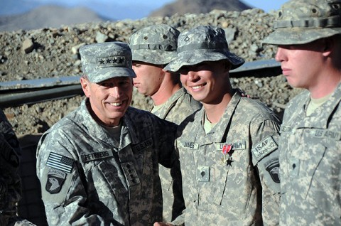 U.S. Army Gen. David H. Petraeus International Security Assistance Force commander, shakes the hand of U.S. Army Spc. Timothy James of Gilbert, AZ, after pinning him with a Bronze Star Medal with Valor at Combat Outpost Margah Nov. 11th. (Photo by U.S. Army Sgt. Maj. Hector Santos, Task Force Currahee)