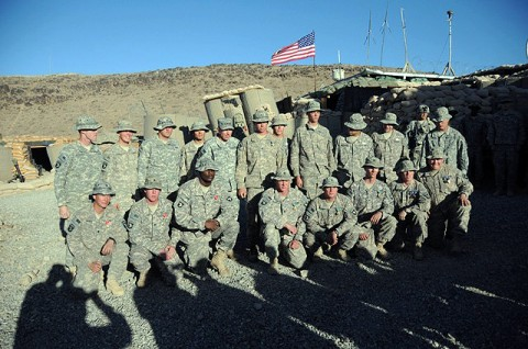 U.S. Army Gen. David H. Petraeus (Center), International Security Assistance Force commander, takes a group picture with the men of C Company, 2nd Battalion, 506th Infantry Regiment, 4th Brigade Combat Team, 101st Airborne Division, after awarding the Soldiers for their actions during an Oct. 30 attack on Combat Outpost Margah. (Photo by U.S. Army Sgt. Maj. Hector Santos, Task Force Currahee)