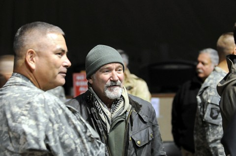 Bagram Airfield, Afghanistan – Actor and comedian Robin Williams talks with U.S. Army Maj. Gen John F. Campbell, Combined Joint Task Force 101 and Regional Command East commander, before the Annual USO Holiday Tour on Bagram Airfield Dec. 15th. (Photo by U.S. Army Staff Sgt. Michael L. Sparks, 17th Public Affairs Detachment)