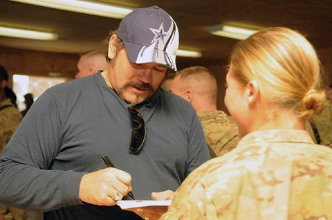 Country Music singer Buddy Jewell of Nashville, Tennessee, signs autographs for Soldiers of 94th Brigade Support Battalion's Task Force Strength, 4th Brigade Combat Team, 10th Mountain Division, during a USO visit to Forward Operating Base Shank Dec. 21st. (Photo by U.S. Army Spc. Brian P. Glass, Task Force Patriot Public Affairs)