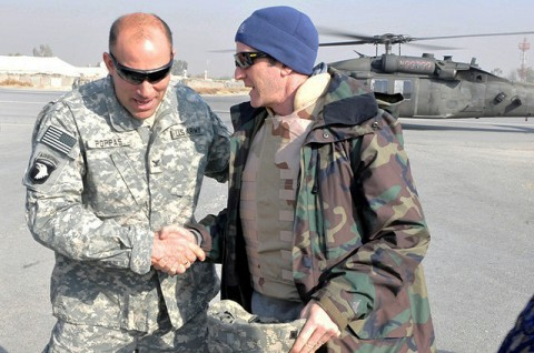 U.S. Army Col. Andrew P. Poppas of Janesville, WI, Task Force Bastogne commander, greets Lance Armstrong upon arrival to Forward Operating Base Fenty in eastern Afghanistan's Nangarhar Province Dec. 15th. (Photo by U.S. Army Spc. Richard Daniels Jr., Task Force Bastogne Public Affairs)
