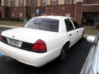 White Crown Victoria possibly used to impersonate a Police Car.