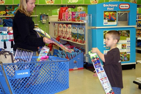 Mother and son shopping for kites