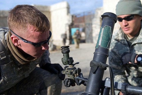 U.S. Army Spc. Shane Harris from 1st Platoon, Company B, 1st Battalion 187th Infantry Regiment, 101st Airborne Division, and a Dublin, IN, native, sets up a 60 mm mortar system upon occupying a vacant housing area to provide indirect fire for his company during a mission in Sabari District Dec. 30th. (Photo by U.S. Army Staff Sgt. Andrew Guffey, Task Force Rakkasan)