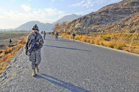 U.S. Army Spc. Cristine Gallagher of Victorville, CA, machine-launched grenade gunner for the 64th Military Police Company based at Combat Outpost Fortress, conducts a foot patrol through Noor Gal District Jan. 3rd. (U.S. Army photo by U.S. Air Force Capt. Peter Shinn/RELEASED)