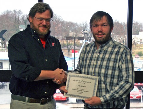 Dr. Donald Sudbrink, assistant professor of agriculture at APSU, presents a scholarship certificate from the Tennessee Council of Cooperatives (TCC) to Cody Norrod, a senior at APSU. (Photo provided by the TCC)