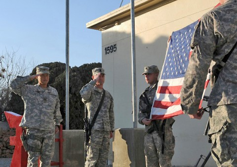 U.S. Army Col. Viet Luong and U.S. Command Sgt. Maj. Gregory Patton, commander and command sergeant major of the 3rd Brigade Combat Team, 101st Airborne Division based out of Fort Campbell, KY, salute the World Trade Center flag at Forward Operating Base Salerno Jan. 24th. (U.S. Army photo by Spc. Tobey White, Task Force Duke Public Affairs)