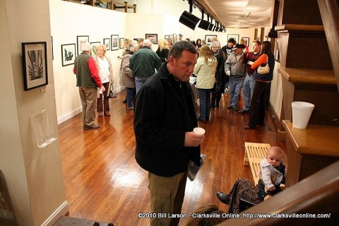 A standing room only crowd at the Friends of Photography Exhibit at the Downtown Artists Co-Op