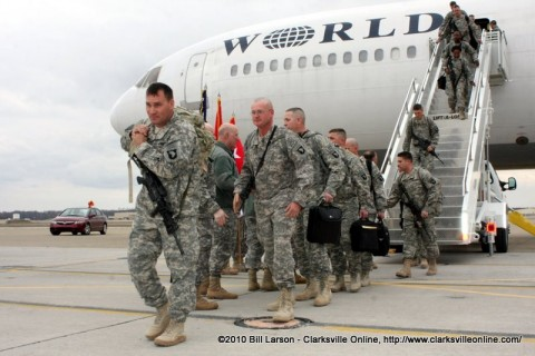 The first 3rd Brigade Combat Team soldier heads for the hanger after getting off the plane.