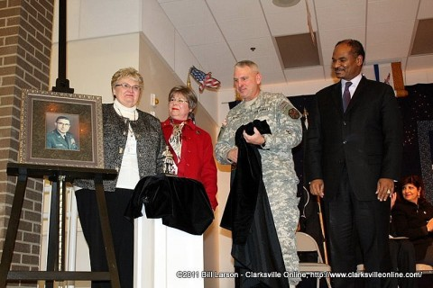 Principal Jennifer Halley; Bette Barsanti Sherman; Col. Perry Clark; and Robert Gordon, Deputy Under Secretary of Defense for Military Community and Family Policy, unveil a portrait and statue of General Olinto M. Barsanti at a dedication ceremony Friday for the Barsanti Elementary School on Fort Campbell.