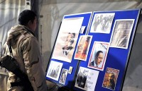 U.S. Navy Petty Officer 2nd Class Jake Liao, a San Francisco Bay native and a construction mechanic, looks at a biography and photos of Dr. Martin Luther King Jr. during an event to honor Dr. King on Bagram Airfield, Afghanistan, Jan. 17th. (Photo by U.S. Army Sgt. Scott Davis, Regional Command-East Public Affairs)
