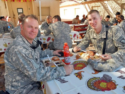 Col. James Pillow, Task Force MED-East chief of operations, and U.S. Army Pfc. John L. Pillow, a medic, 101st Airborne Division, eat Thanksgiving dinner together at Forward Operating Base Connolly in Nangarhar Province Nov. 25th. James and John Pillow are both assigned to Regional Command-East, eastern Afghanistan. (Photo by U.S. Air Force Capt. Bridgette Scott, Task Force MED-East)
