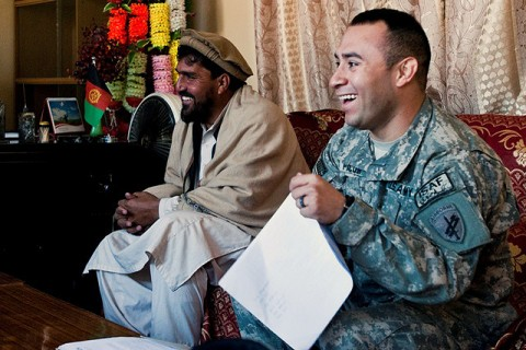 U.S. Army Staff Sgt. Ruben A. Picon, 1st Brigade Combat Team, 101st Airborne Division, from Lubbock, Texas, enjoys a friendly exchange at the Bati Kot subgovernor's office Jan. 15th, during a meeting with village elders to discuss projects in and around the Bati Kot District in eastern Afghanistan's Nangarhar Province. (Photo by U.S. Army Sgt. Ginifer Spada, Task Force Bastogne Public Affairs)