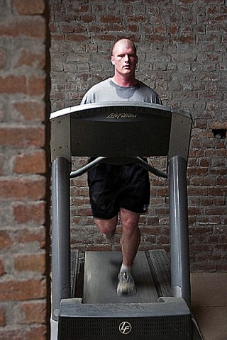 U.S. Army Pfc. Gregory K. Martin, Task Force Panther, runs in Forward Operating Base Connolly's gym in eastern Afghanistan's Nangarhar Province Dec. 22nd. Martin has lost more than 30 pounds this deployment. (Photo by U.S. Army Staff Sgt. Mark Burrell, Task Force Bastogne Public Affairs)