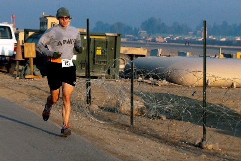 U.S. Army Maj. Patrick Smock of Liberty Hill, Texas, runs the Miami Marathon satellite race at Forward Operating Base Fenty in eastern Afghanistan Jan. 30th. Smock, an orthopaedic surgeon assigned to 745th Forward Surgical Team and attached to 1st Brigade Combat Team, 101st Airborne Division, ran the 26.2-mile marathon in 3 hours, 27 minutes in eastern Afghanistan. (Photo by U.S. Army Spc. Richard Daniels Jr., Task Force Bastogne Public Affairs)