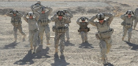 """U.S. Army Soldiers from 4th Brigade Combat Team, 101st Airborne Division, do lunges as part of the """"stress shoot"""" at Forward Operating Base Sharana Jan. 9th. (Photo by U.S. Army Sgt. Luther L. Boothe Jr., Task Force Currahee Public Affairs)"""