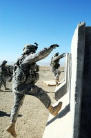 "U.S. Army Soldiers from 4th Brigade Combat Team, 101st Airborne Division, maneuver over an obstacle as part of the ""stress shoot"" at Forward Operating Base Sharana Jan. 9th. (Photo by U.S. Army Sgt. Luther L. Boothe Jr., Task Force Currahee Public Affairs)"