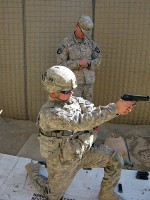 U.S. Army Sgt. Kent Uhler from Scottsburg, IN, with Forward Support Company, 3rd Battalion, 187th Infantry Regiment, takes his turn at the 9 mm pistol competition. (Photo by U.S. Army 1st Lt R.J. Peek, Task Force Rakkasan)